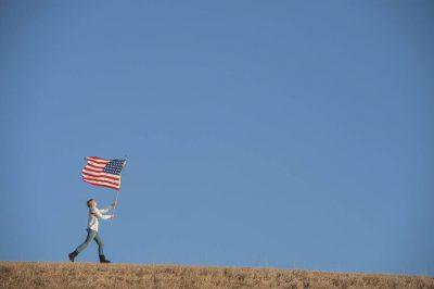 Photo: A teenage girl with an American flag.