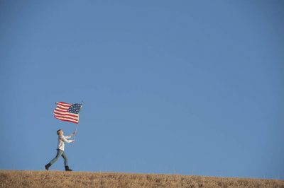 Photo: A teenage girl with an American flag.