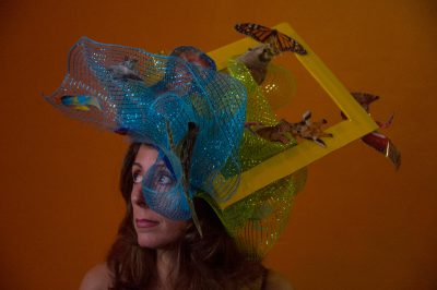 Photo: A women wears a hand crafted hat promoting National Geographic.