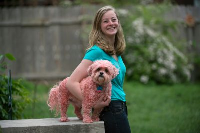 Photo: A teenage girl poses with her dog Baxter, the Shih tzu, dyed pink.