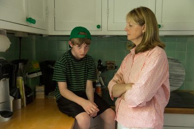 Photo: A sulking boy and his mother in Lincoln, Nebraska.