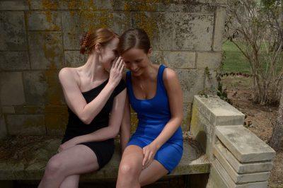 Photo: Two friends share a secret, Lincoln, Nebraska.