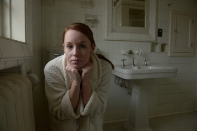 Photo: A young woman poses in a bathroom, Lincoln, Nebraska.