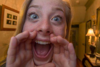 Photo: A teenage girl, 16, yells at the camera, Lincoln, Nebraska.