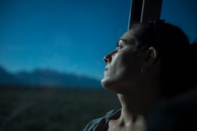 Photo: A woman looks out a tour bus window at Yellowstone National Park, Wyoming.