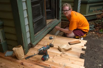 Photo: Cole Sartore work on the Lewis-Syford house, one of the oldest homes in Lincoln, circa 1879.