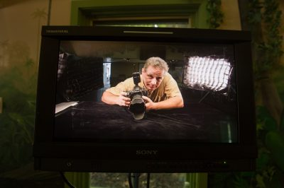 Photo: Joel Sartore prepares for a photo shoot at the Lincoln Children's Zoo.