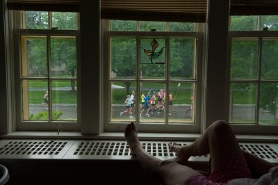 Photo: A woman watches a marathon from the comfort of her home.