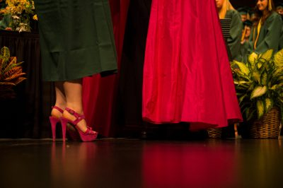 Photo: The feet of teenage girl wearing high heels as she receives her high school diploma.