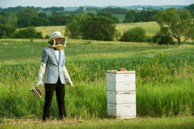 Photo: A man models with a beehive in Bennet, Nebraska.