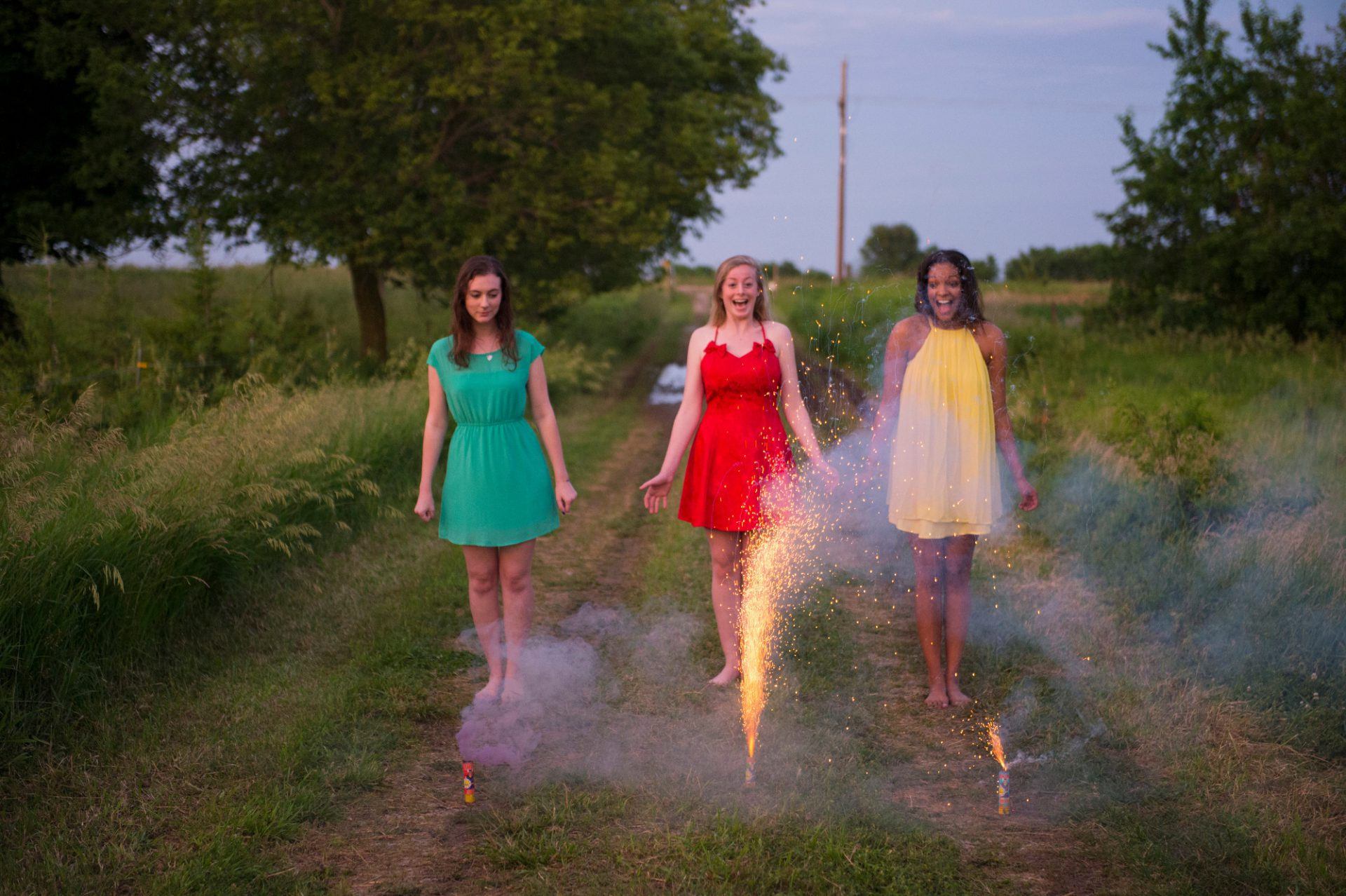 Photo: Three young women light fire crackers in Bennet, Nebraska.