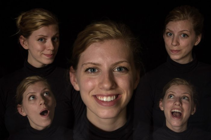 Photo: A young woman has several portraits in one frame with a multiple exposure technique.
