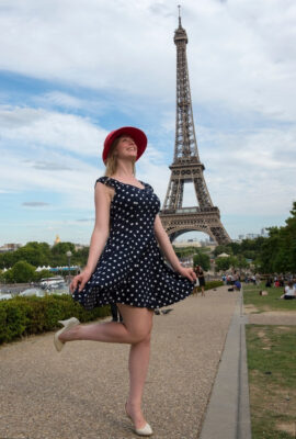 Photo: A teenage girl visits the Eiffel Tower in Paris, France.