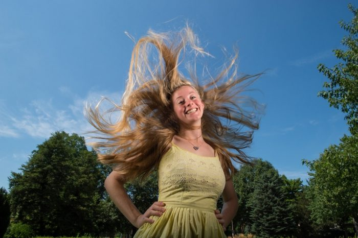 Photo: A teenage girl's blonde hair surrounds her head.