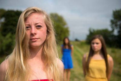 Photo: Three teenage girls on a country road.