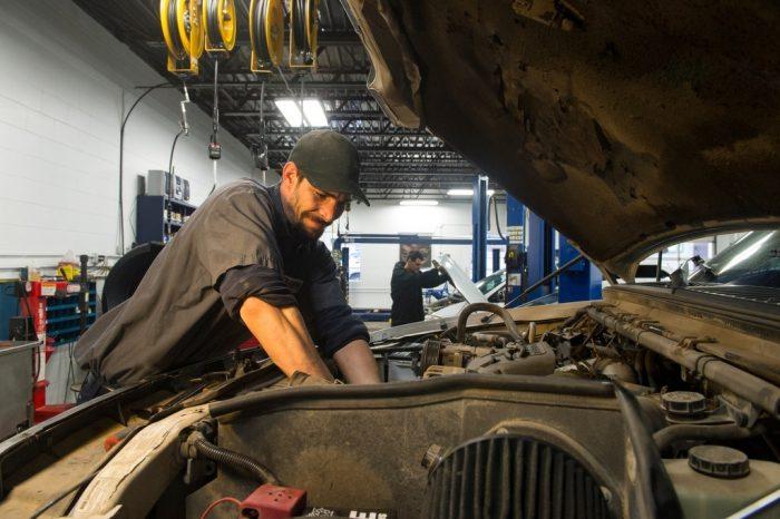 Photo: A mechanic repairs a car.