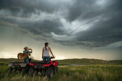 Photo: Two women on their four wheelers admiring the incoming storm.