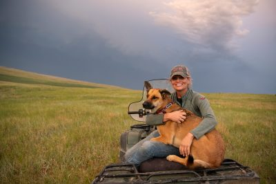 Photo: A woman poses with her dog on a four wheeler.