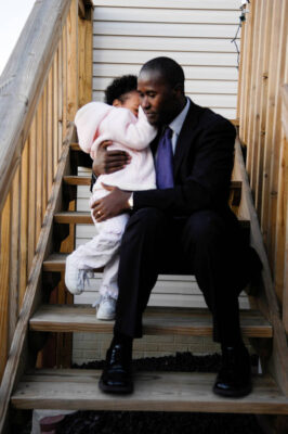 Photo: A father comforts his daughter outside their suburban home in Lincoln, Nebraska.