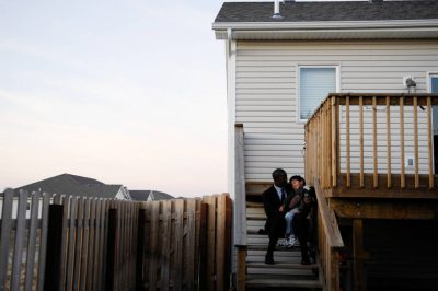 Photo: A father and son outside their suburban home in Lincoln, Nebraska.