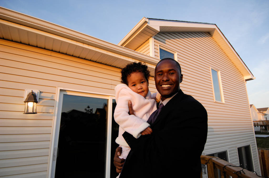 Photo: A father and his daughter outside their suburban home in Lincoln, Nebraska.