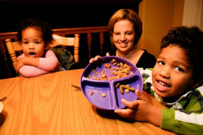 Photo: A mother and her children have dinner in their suburban home in Lincoln, Nebraska.