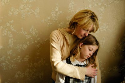 Photo: A woman comforts her daughter at their home.