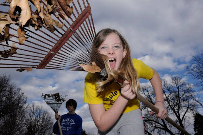 Photo: Two siblings protest raking leaves in Lincoln, NE.