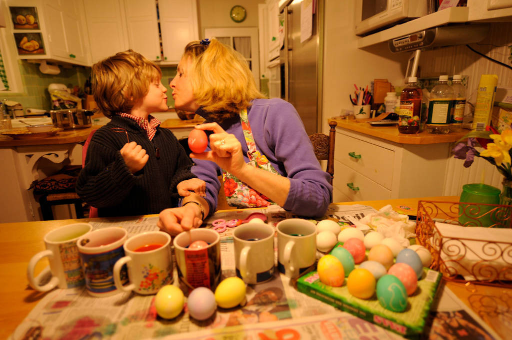 Photo: A mother and son decorate Easter eggs.