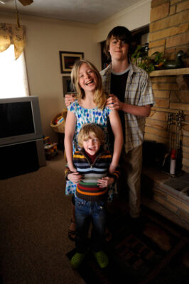 Photo: Three siblings gather for a portrait on Easter.