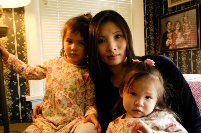 Photo: A mother and her young daughters.