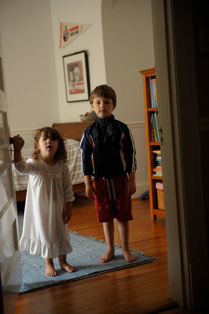 Photo: A brother and sister stand in a doorway at their home in Washington D.C.