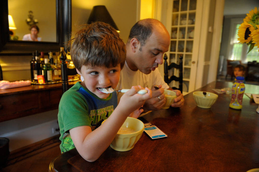 Photo: A father and his son eat breakfast together at their home in Washington D.C.