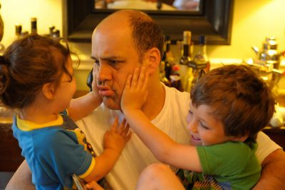Photo: A father plays with his son and daughter at their home in Washington D.C.