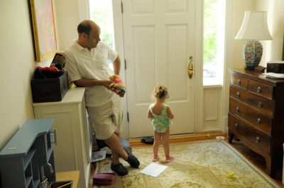 Photo: A father with his daughter in the entryway of their home in Washington D.C.