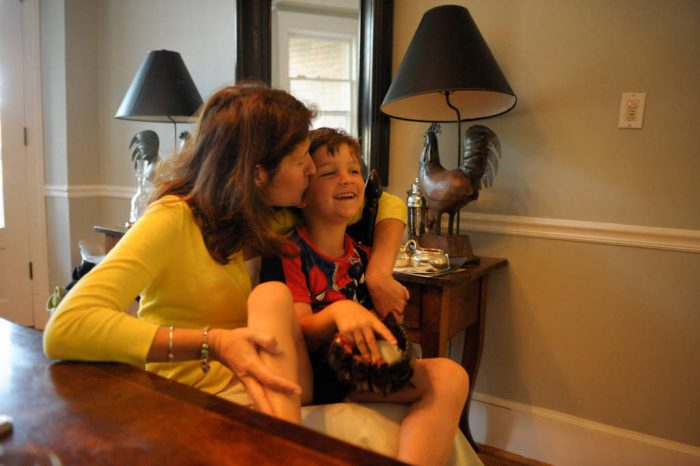 Photo: A mother kisses her son at their home in Washington D.C.