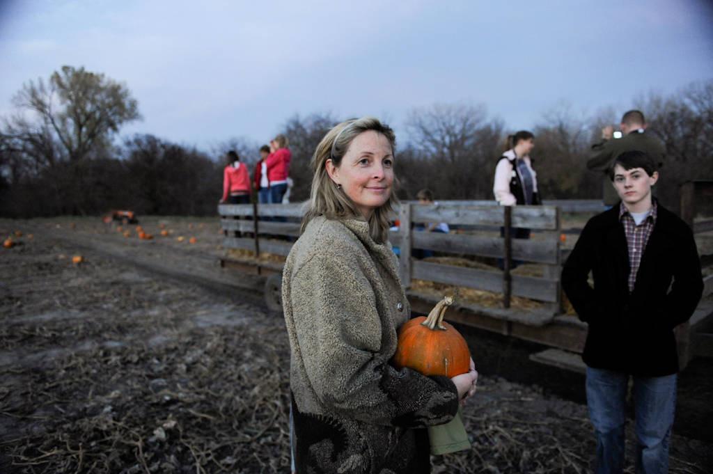 Photo: A woman and her son hold a pumpkin at Roca Berry Farm's pumpkin patch in Roca, NE.
