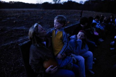 Photo: A mother with her son and daughter on a hayrack ride at Roca Berry Farm in Roca, NE.