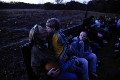 Photo: A mother kisses her son on a hayrack ride at Roca Berry Farm in Roca, NE.