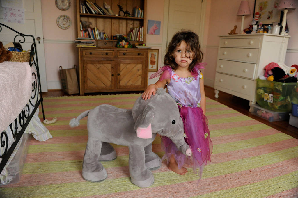 Photo: A young girl plays dress up in a princess costume in her bedroom at her home in Washington, D.C.