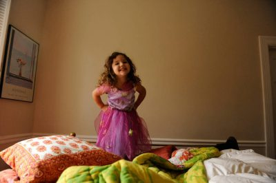 Photo: A young girl plays dress up in a princess costume at her home in Washington D.C.