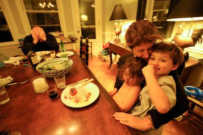 Photo: A woman sits with her son and daughter at the dinner table at their home in Washington D.C.