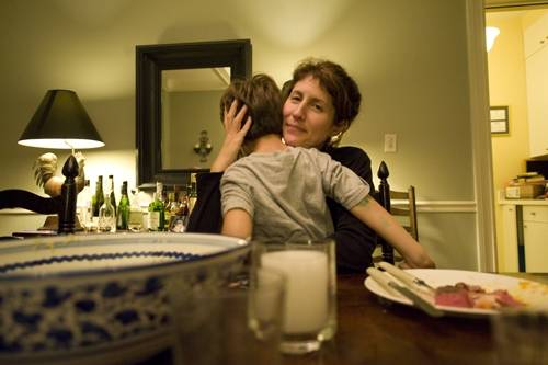Photo: A mother comforts her son while sitting at the dinner table in their home in Washington, D.C.