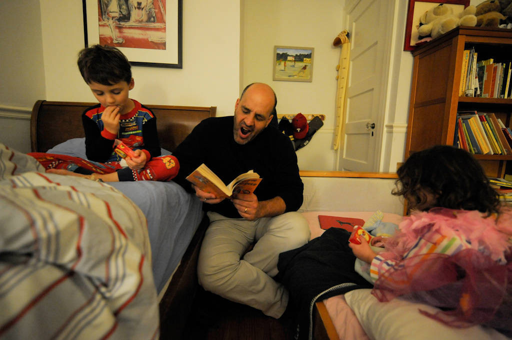 Photo: A father reads a book to his son and daughter before bed at their home in Washington, D.C.