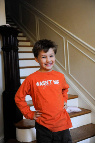 Photo: A boy poses for a picture of his shirt at his home in Washington D.C.