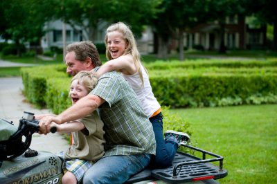 Photo: A family rides a four wheeler in Lincoln, Nebraska