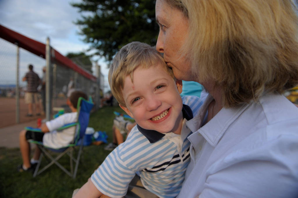 Photo: A mother and son at a softball game.