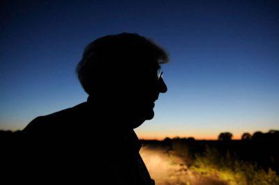 Photo: A silhouette of a senior man.