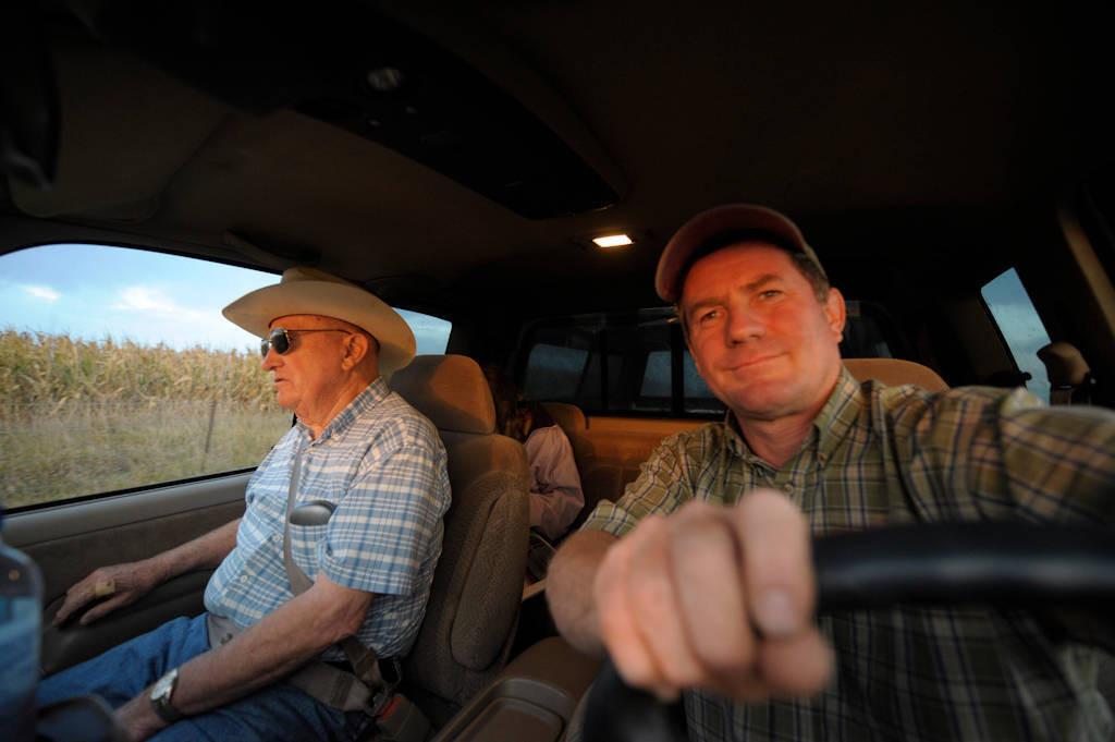 Photo: A senior man and his son go fishing.