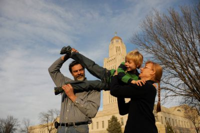 Photo: A family portrait outside the Nebraska state capitol building.